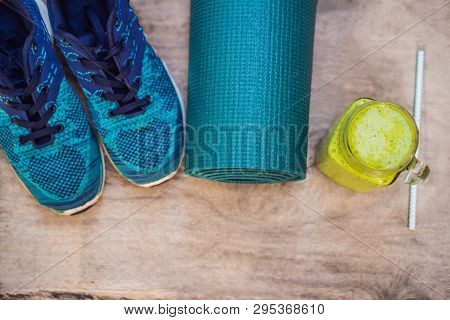 Everything For Sports Turquoise, Blue Shades On A Wooden Background And Spinach Smoothies. Yoga Mat,