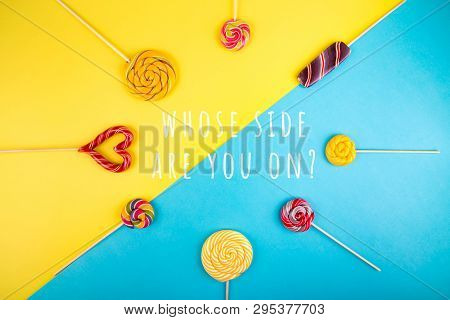 Many Colorful Lollipop Candys Arranged In Circle Form With Empty Space In The Center On Yellow And B