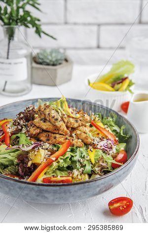 Quinoa Fresh Vegetable Salad In A Blue Ceramic Dish