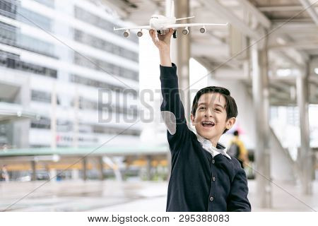 Young Boy Playing Aviator Toy Air Plane Imagination Dreaming Of Being A Pilot Future On Business Dis