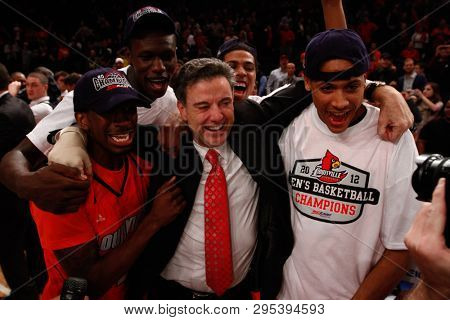 NEW YORK-MAR 10: Louisville Cardinals head coach Rick Pitino celebrates after winning the Big East Tournament vs the Cincinnati Bearcats on March 10, 2012 in New York.