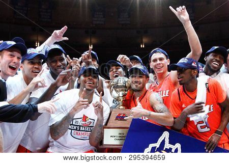 NEW YORK - MAR 10: Louisville Cardinals players celebrate after winning the Big East championship game against the Cincinnati Bearcats at Madison Square Garden in New York City.