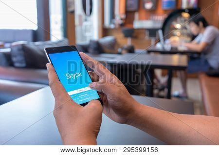 Chiang Mai, Thailand - Mar 18,2018: Man Holding Huawei With Skype Apps. Skype Is Part Of Microsoft,