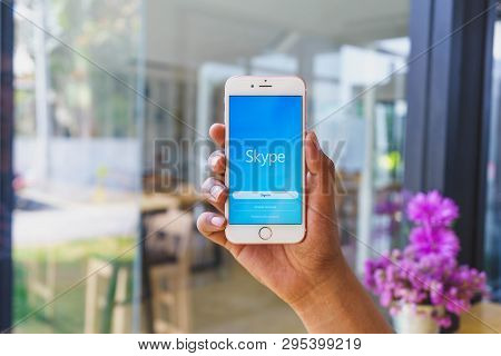 Chiang Mai, Thailand - Mar 02,2018: Man Holding Apple Iphone 6s Rose Gold With Skype Apps. Skype Is
