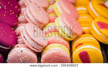 Bright Beautiful Macaroons With Tender And Flavorful Cream. The Contrast Of Colors And The Ideal For