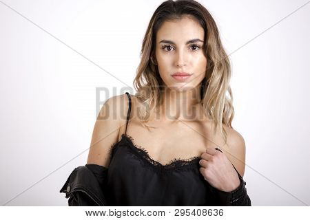 Beauty Girl In Black Leather Jacket Studio Shoot