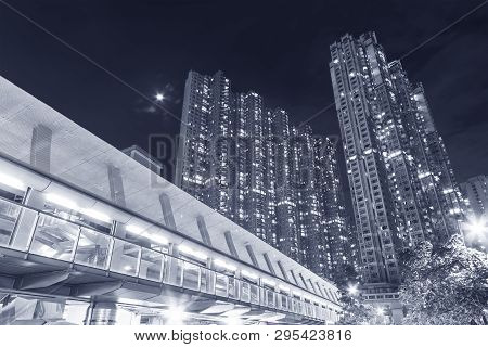 Modern High Rise Residential Building In Hong Kong City At Night