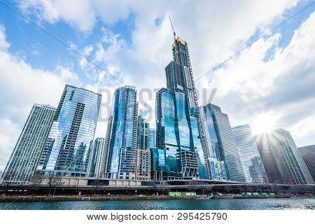 Modern Tower Buildings Or Skyscrapers In Business District, Reflection Of Cloud On Sunny Day In Chic