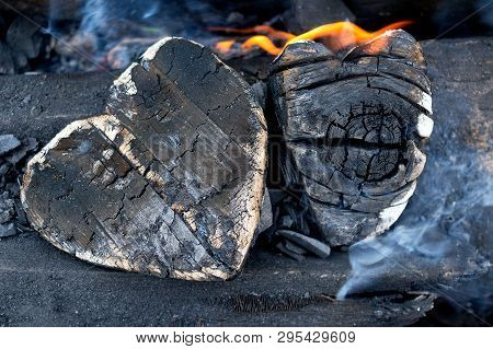 Hot Coals And Burning Woods In The Form Of Human Heart. Glowing And Flaming Charcoal, Bright Red Fir