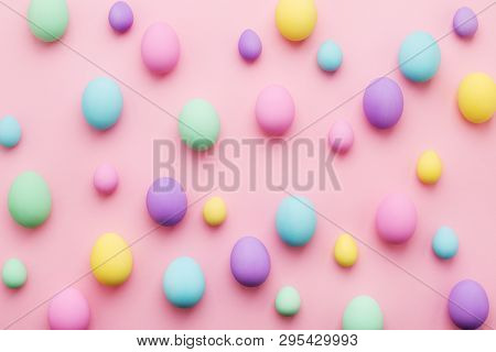 Pastel Colored Easter Eggs Pattern On Pink Background. Colorful Holiday Card Happy Easter. Minimal S