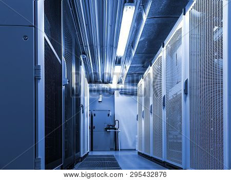 Corridor In Datacenter Server Room For Exchanging Cyber Data, Cloud Computing And Connection