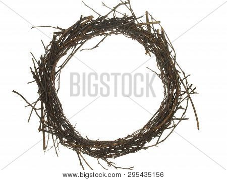Wreath Of Dry Twigs And Wire Isolated On White Background