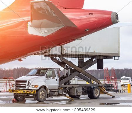 Loading Platform Truck Of Air Freight To The Tail Aircraft. Food For Flight Check-in Services And Eq