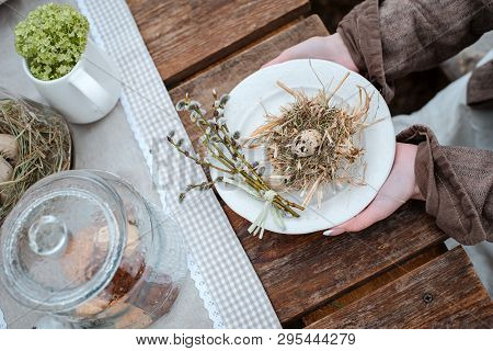 Decorative Straw Nests With Quail Egg Close-up In Female Hands On Vintage Rustic Background. Farm. E