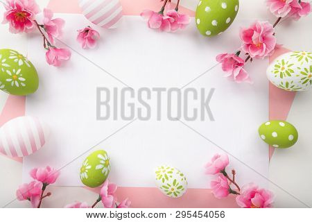 Holidays Background With Easter Eggs On Pink Table
