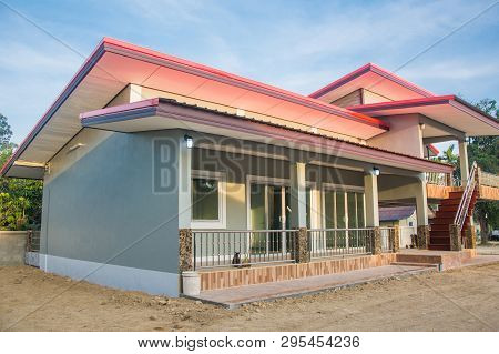 Porch On Front View Of Bungalow New Family House. Asia Style Design