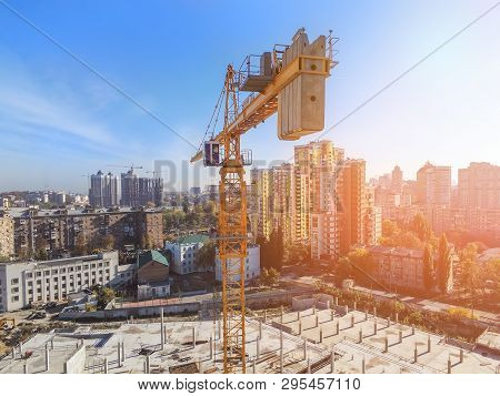 Heavy High Tower Crane View At Skyscraper Conctruction Site. Industrial Building Background