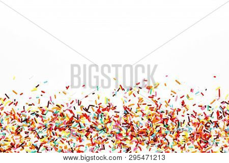 Multicolored Sugar Sprinkle Dots, Decoration For Cake, Isolated On White. Birthday And Holiday Backg