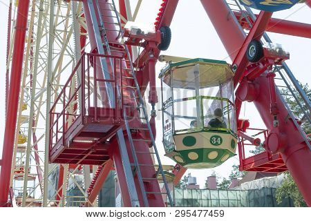 Kharkov, Ukraine - 30th April, 2018: Beautiful Bright Color Wheel In An Amusement Park. People Insid