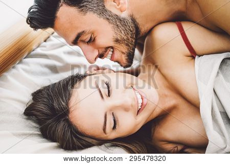 Happy Romantic Couple Having Sex - Young Lovers During Foreplay Having Tender And Intimate Moments I