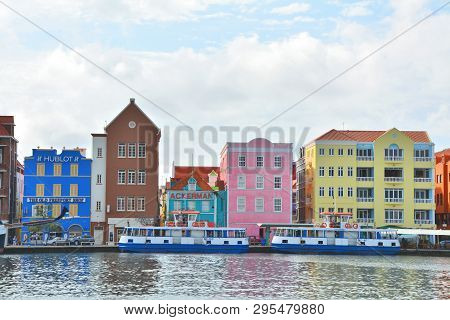 Willemstad, Curacao - March 27, 2017: Waterfront With Colorful Houses In Willemstad, Caribbean.the C
