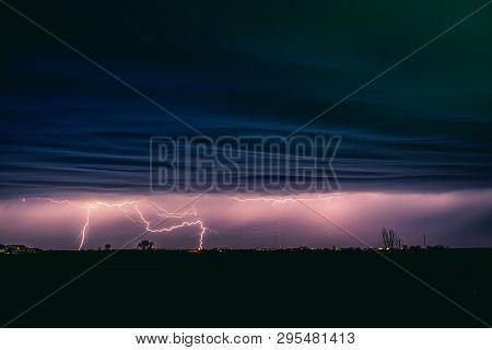 View Of Lightning Strike Over A Rural Farm Field, Lightning Strikes The Ground, Strong Thunder, Ligh