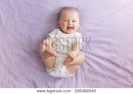 Portrait Of Cute Adorable Smiling Laughing White Caucasian Baby Girl Boy With Blue Eyes Four Months