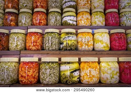 Jars with variety of pickled vegetables. Preserved food.