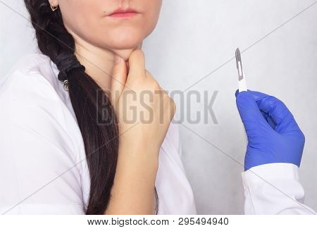 Plastic Surgeon Holding A Scalpel In Her Hand Against The Background Of A Girl With A Double Chin, T