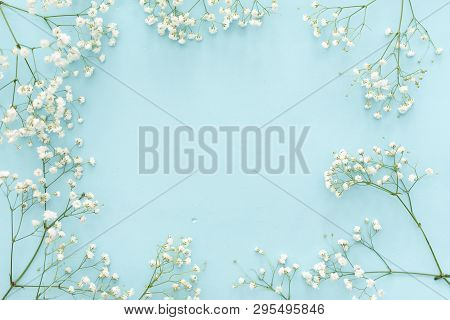 Flowers Composition Romantic. White Gypsophila Flowers, Photo Frame On Pastel Blue Background. Valen