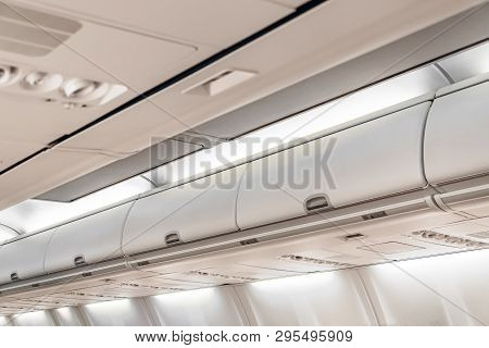 Closed Doors Luggage Shelves In Economy Class Passenger Aircraft