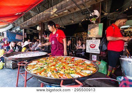 Bangkok, Thailand - March 2019: Man Cooking Seafood At The Chatuchak Weekend Market Street Restauran