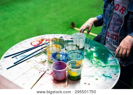 Outdoors Kinder Garden Children Draw With Paints. Active Leisure Time For Kids. Having Fun