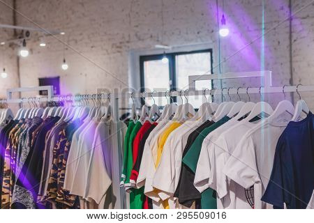 T Shirt Many Color On Rack. T Shirt Store In Shopping Mall, Clothing Shop. Men Wear.