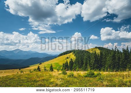 Azure sky background with white fluffy clouds in the sunny day. Location place Carpathian mountains, Ukraine. Template textured sky background. Stunning wallpaper. Weather conditions. Beauty world.