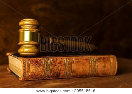 Wooden Judge Gavel, Close-up View. Judge's Gavel On Table. Law And Order. Law And Justice Concept.