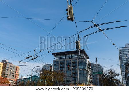 Tangle Of Cables And Power Lines For Seattle Traffic Signs And Trams, Washington, Usa.