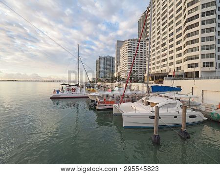 Miami, Florida 11-24-2018 Boats Docked In Back Of Residential Buildings On Biscayne Bay In Early Mor