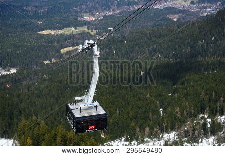 Zugspitze, Germany, April 3, 2019: Ropeway Gondola Or Cable Car With A Lot Of Tourists Is Driving To