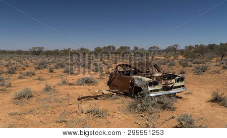 Rusty Wreck Of Crashed Car In The Middle Of Desert (warning To Inattentive Drivers), Stuart Highway,