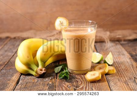 banana smoothie on wood background