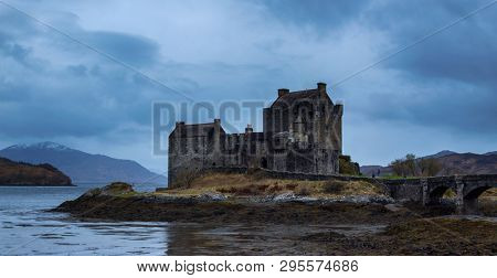 Eilean Donan Castle at Dornie on Kyle of Lochalsh in Scotland with dark clouds