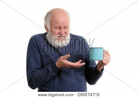 unhappy elderly grey haired man with blue cup of tea or coffe isolated on white