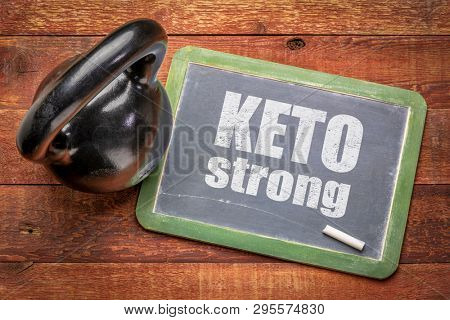 keto strong inspirational text on blackboard with a kettlebell - ketogenic diet and fitness concept