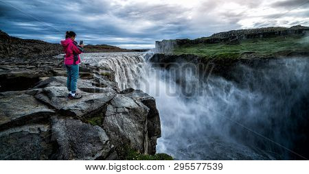 Traveler Travels To Dettifoss Waterfall In Iceland