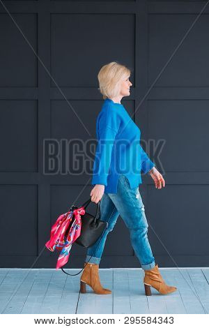 Woman Confidence. Female In Blue Walking. Full Length Shot. Side View. Casual Outfit. Bright Neckerc
