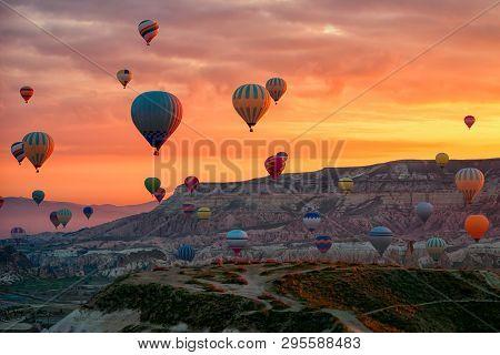 Hot Air Balloons Flying Tour Over Mountains Landscape Spring Sunrice Cappadocia, Goreme Open Air Mus