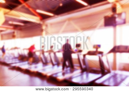 Blurred Background With Fitness Gym People Cardio Workout In Sport Club Center. Blurred Picture Of R