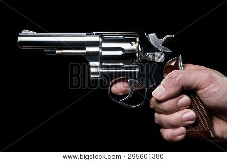 Stainless Gun Or Shooter In Human Hand Side View. Fake Stainless Gun Or Shooter In Hand Portrait Vie