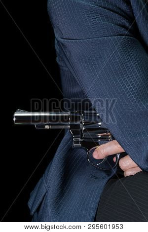 Man Hold Stainless Gun Or Shooter In Hand Side Body In Book Cover Style. Fake Stainless Gun Or Shoot